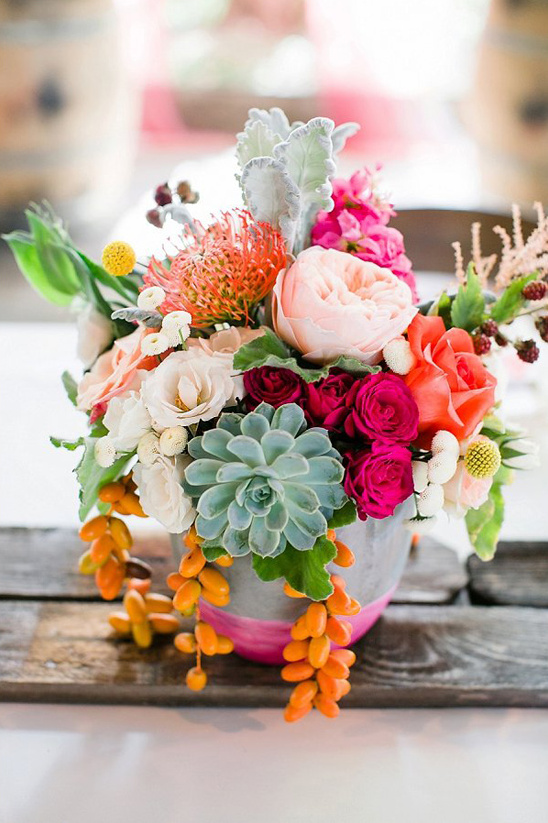 hot pink and orange centerpiece @weddingchicks