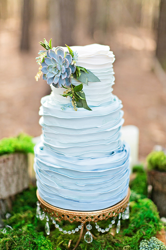 blue ombre ruffle wedding cake with succulent @weddingchicks