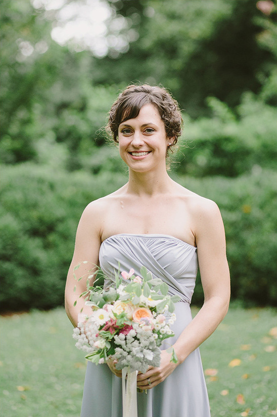 bridesmaid in gray with braided hair