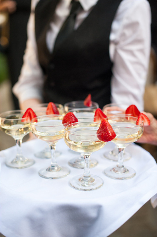 strawberry garnished champagne @weddingchicks