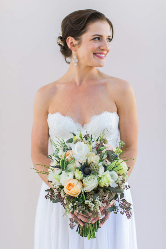 beautiful bride with bouquet by Judy McAuley @weddingchicks