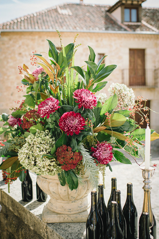 deep red and green flower arrangement @weddingchicks