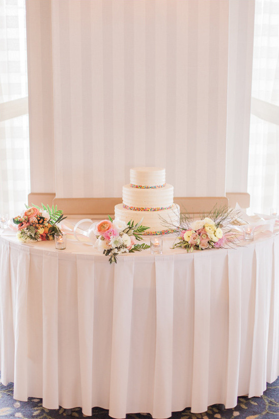 elegant flower covered cake table @weddingchicks