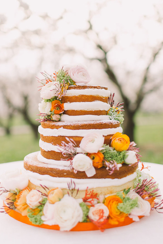 flower accented naked cake @weddingchicks