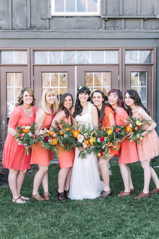 bridesmaids in coral dresses @weddingchicks