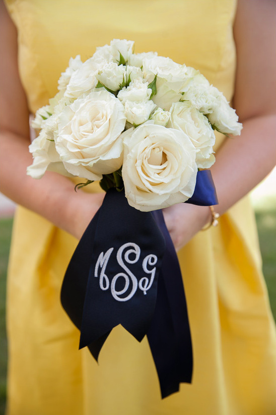 white roses with monogrammed wrap @weddingchicks