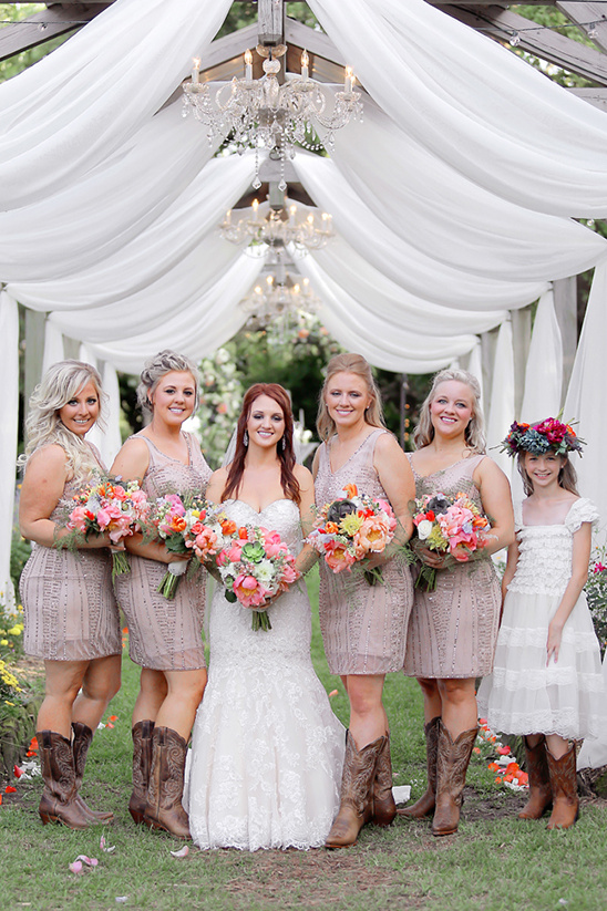 bridesmaids in cowgirls boots @weddingchicks