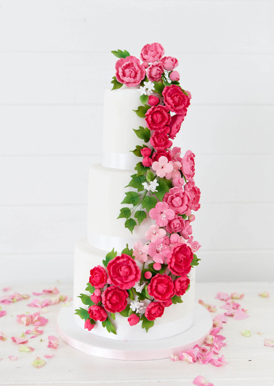 pink flower topped cake @weddingchicks
