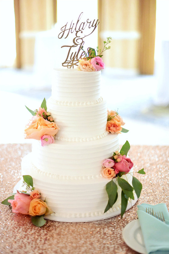 flower topped cake @weddingchicks