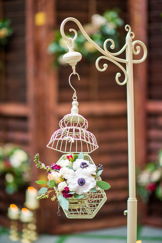 floral bird cage wedding decor @weddingchicks