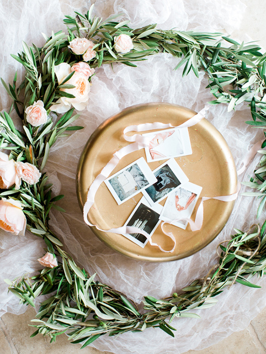 floral wreath and polaroids @weddingchicks