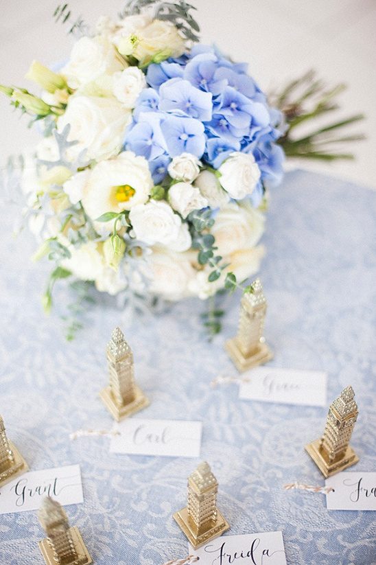 escort card figurines idea @weddingchicks