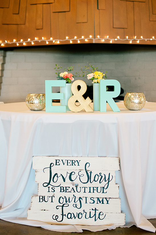 sweetheart table with wooden wedding sign @weddingchicks