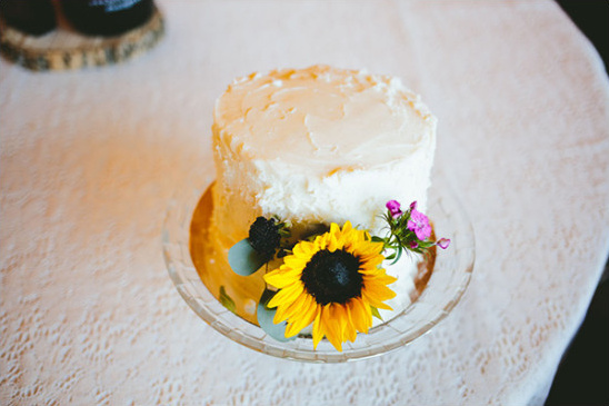 wedding cake with sunflowers @weddingchicks