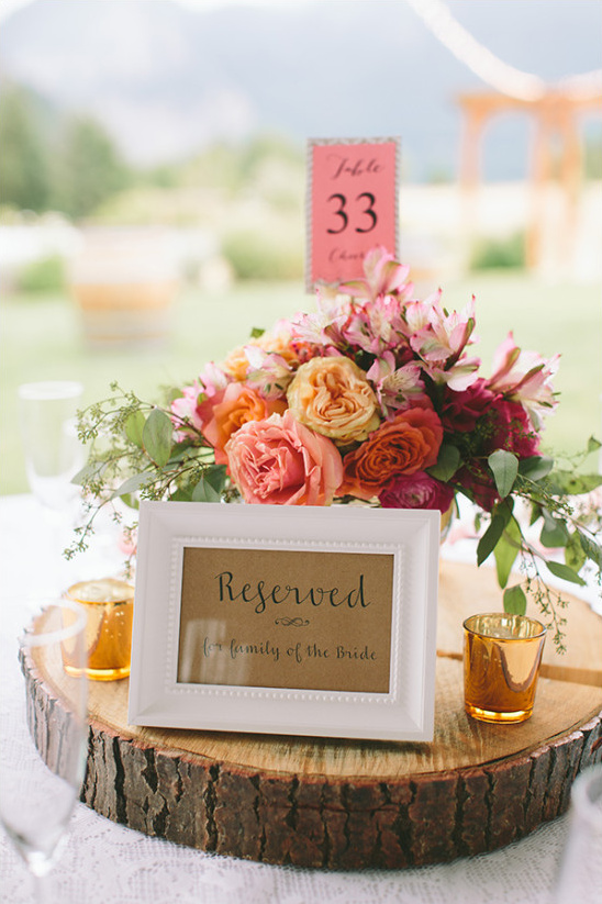 peach pink and orange floral centerpiece @weddingchicks