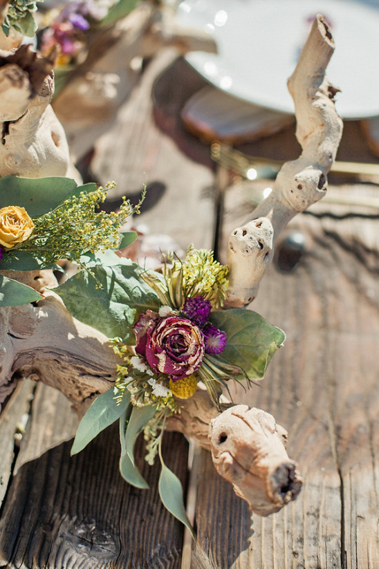 flower covered drift wood centerpiece @weddingchicks