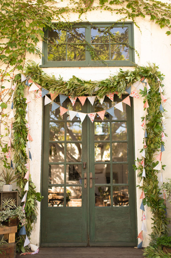 bunting and greenery garland ceremony backdrop
