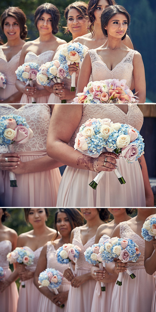 soft pink bridesmaids with blue and pink bouquets