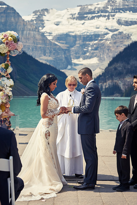 exchanging rings in an outdoor ceremony