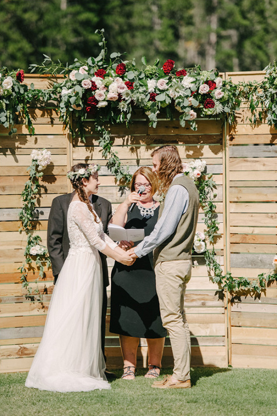 wood and flower wedding ceremony backdrop