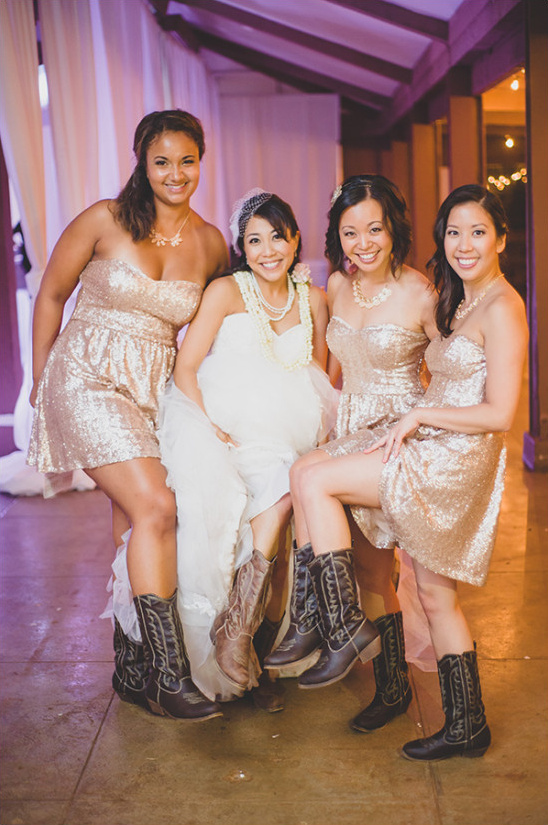 Bridesmaids in gold and cowgirl boots