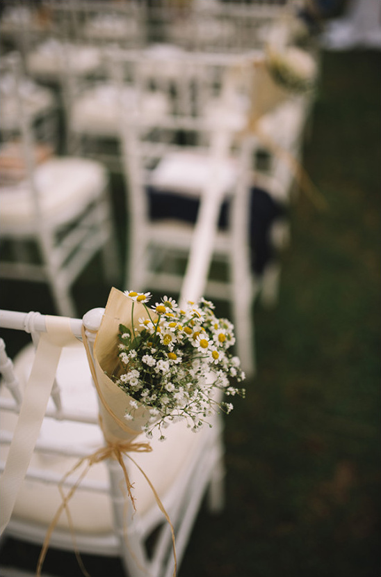 Ceremony aisle flower decor with daisies and babys breath