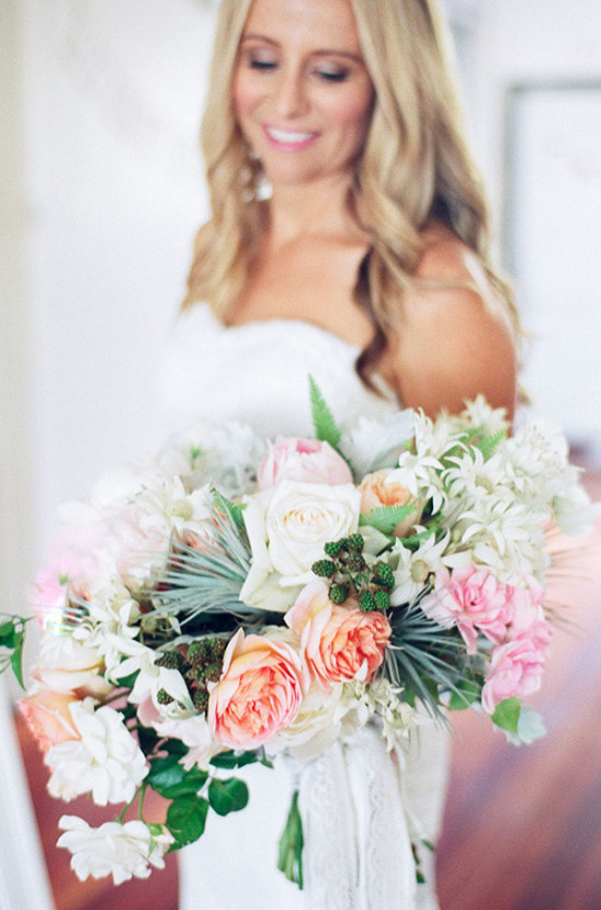 Stunning wedding bouquet with soft peach and pink tones