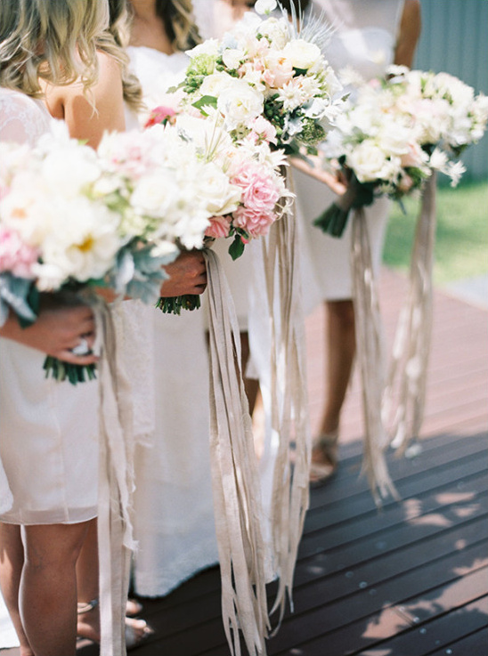 Bridesmaid bouquets with long silk ribbons