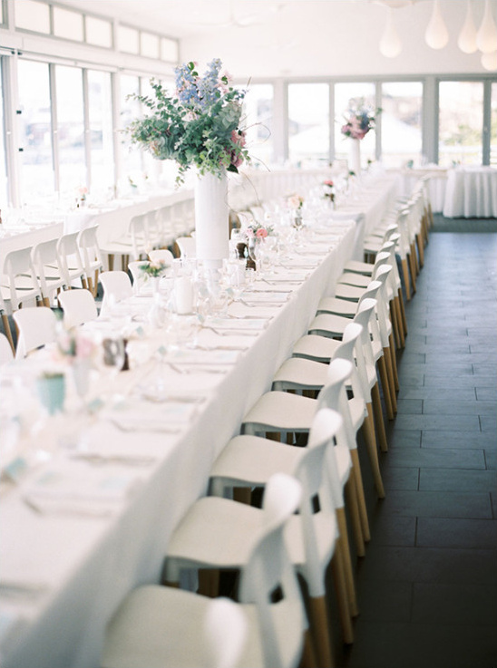 Elegant white reception with minimal pops of color