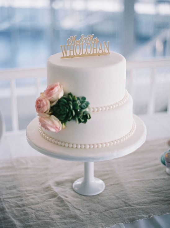 Two tier wedding cake with succulent and pink rose details