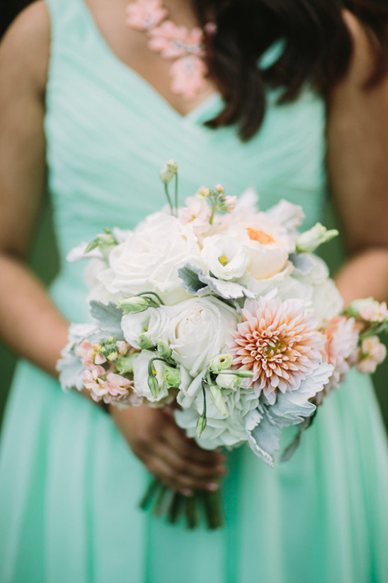 mint bridesmaid with white bouquet