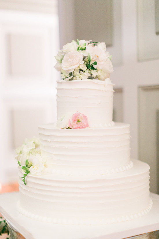 White and pink three tier wedding cake