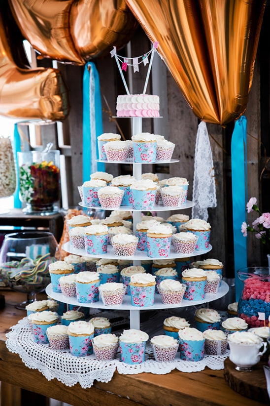 cupcake tower topped by mini cake