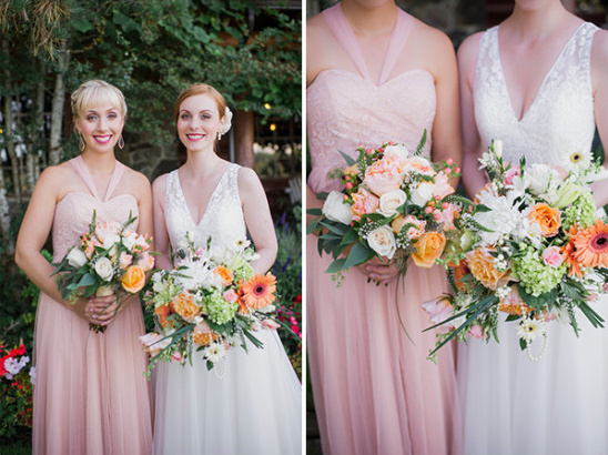 pink bridesmaid with peach and orange bouquet