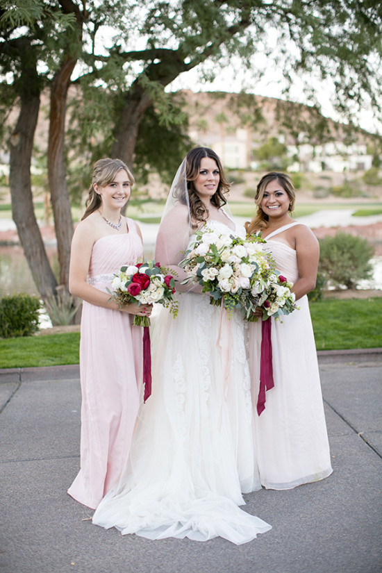 soft pink bridesmaids with red and white bouquet