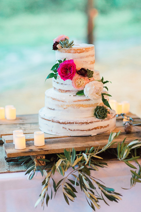 Naked wedding cake with pink peach and green