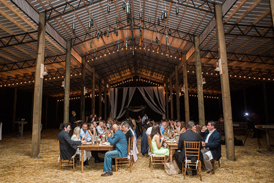 Barn wedding idea with family style farm tables