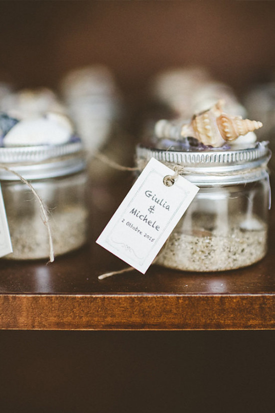 Jars of sand wedding favor with seashells