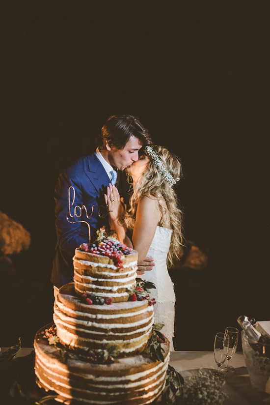 Naked wedding cake kiss