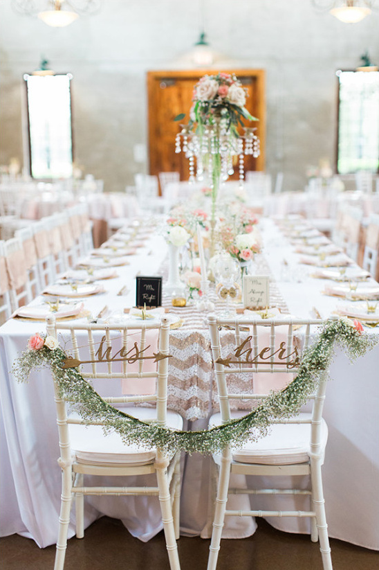 his and hers seats with babys breath garland