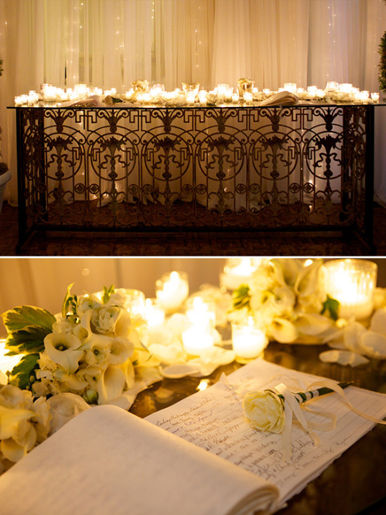 Candle lit guest book table