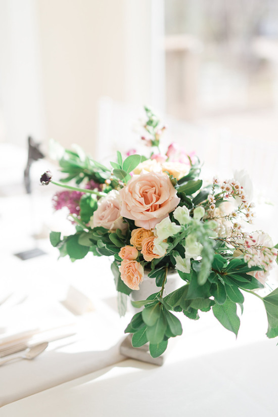 peach and pink and green floral centerpiece