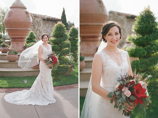 Bridal lace gown with red and blush bouquet