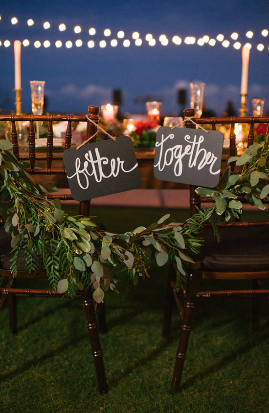Sweetheart chair with signs