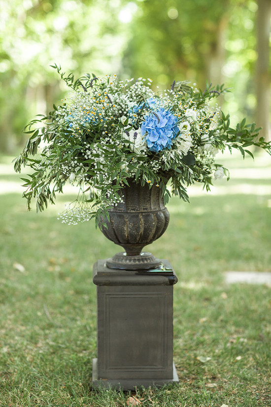 blue and white pedestal flower arrangement