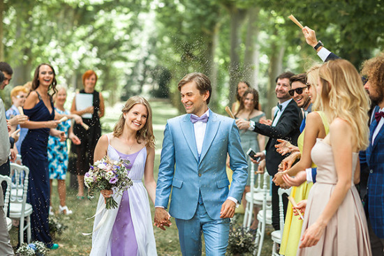 newlyweds with lavendar seeds confetti