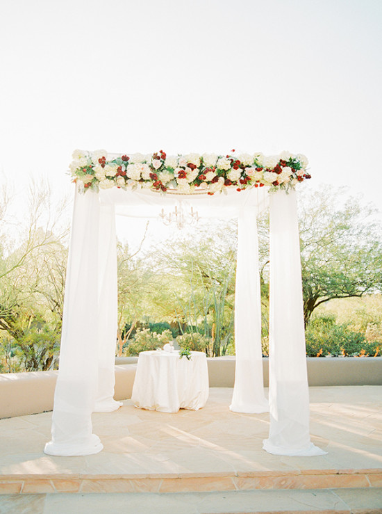 Wedding chuppah canopy with red and white flowers
