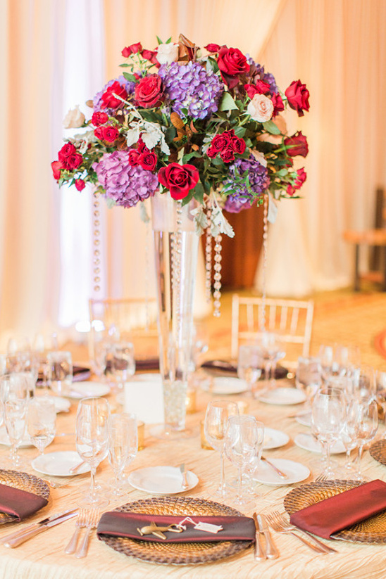 Tall red and purple centerpiece