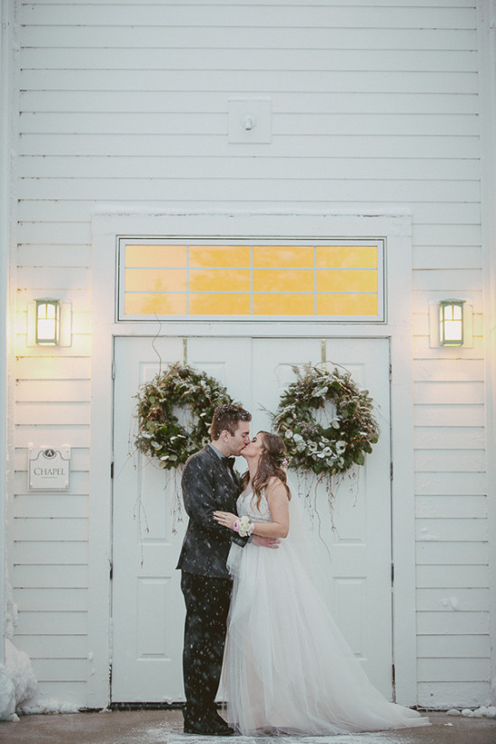 Romantic winter wedding at a snowy chapel