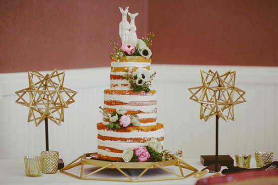 Naked wedding cake with deer topper